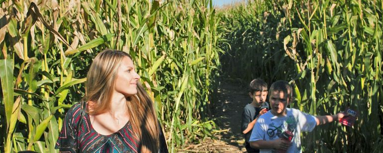 A woman and three children find their way through the tall corn at the Corn Maize at The Pumpkin Patch on Sauvie Island.