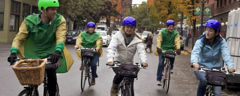 Five cyclists enjoying a bike tour in downtown Portland.
