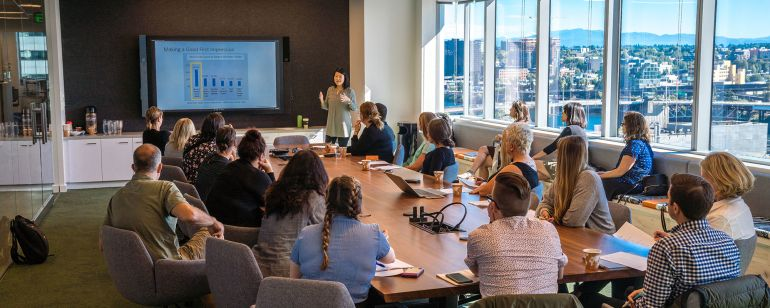 Local business partners receive training in the Hawthorne Bridge room