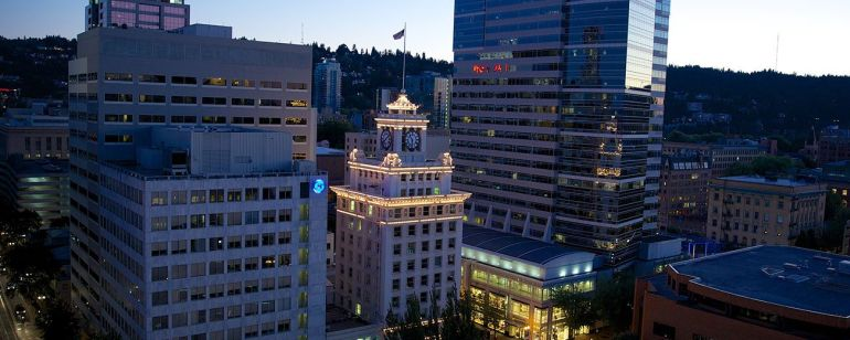 tall buildings at night in downtown Portland