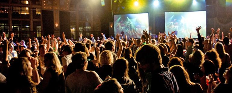 a crowd dancing at a nightclub