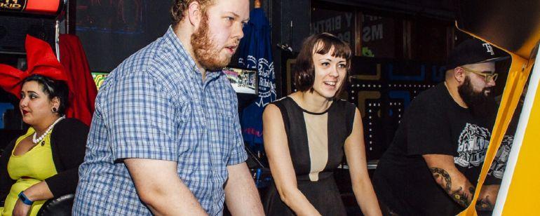 two people playing arcade games at Ground Kontrol