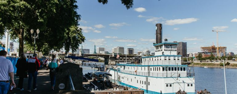 a boat is docked along the portland waterfront