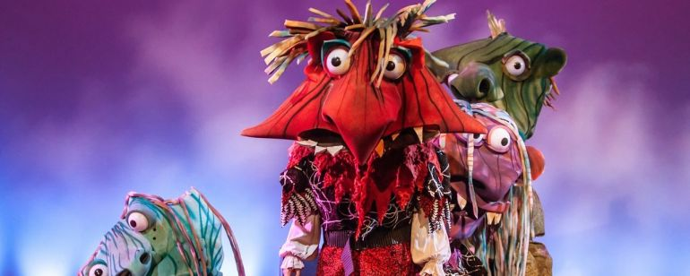 Four large headed scary/funny monsters on stage
