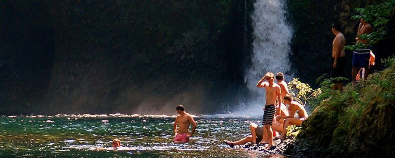 Happy swimmers spend a hot summer afternoon in the cool, clear waters of Punchbowl Falls.