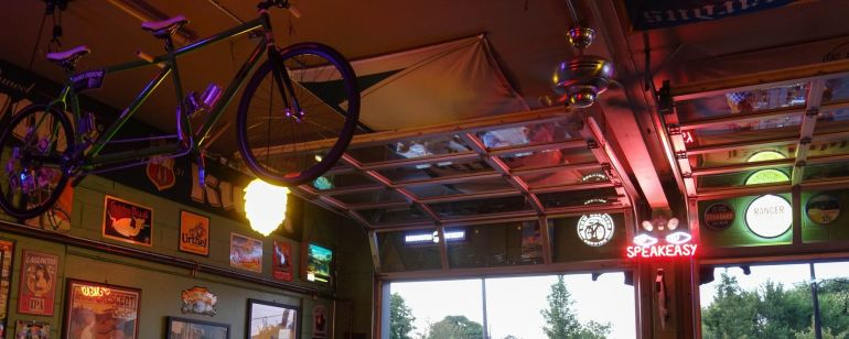 a bike hanging from the ceiling at Apex bar