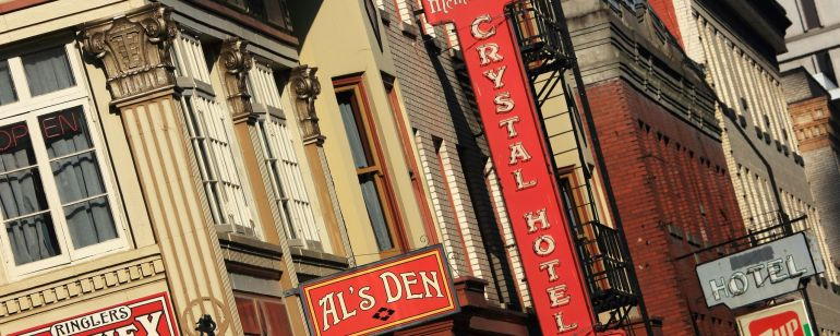 A historic building with a variety of business signs