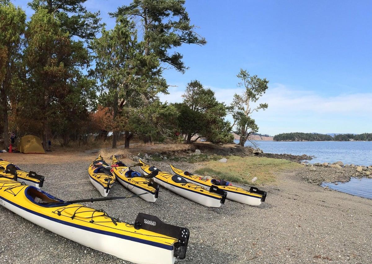 Sea Kayaks on a remote beach in the San Juan Islands.