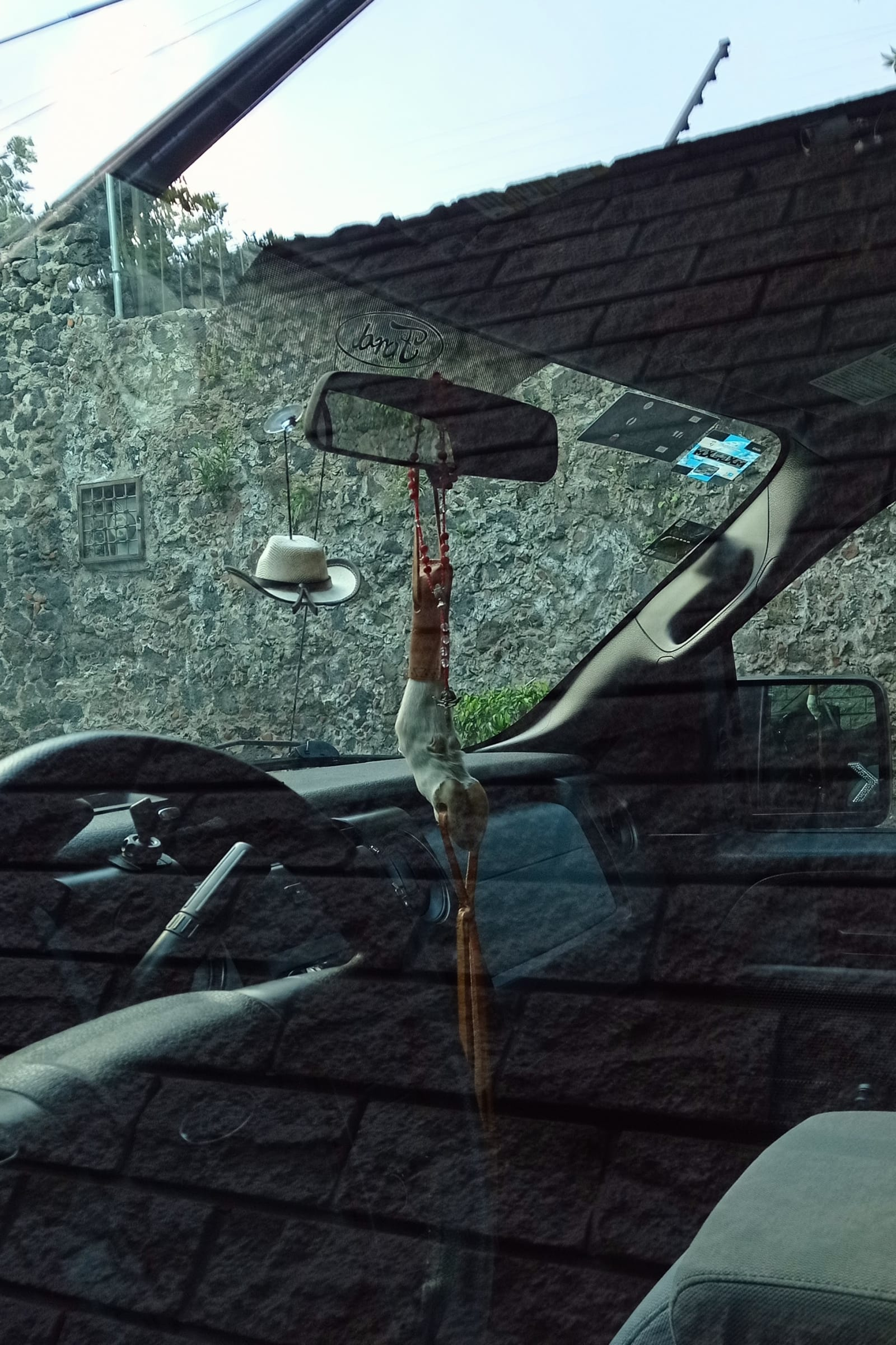 lucky man - two amulets are suspended in a Ford 4x4 - amulets (2), Ford 4x4 - paul lahana