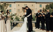 Allegretto Vineyard Resort Paso Robles Weddings - Exchanging Vows in Courtyard