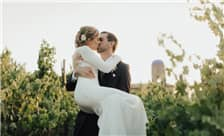 Allegretto Vineyard Resort Paso Robles Weddings - Couple Kissing in Vineyard