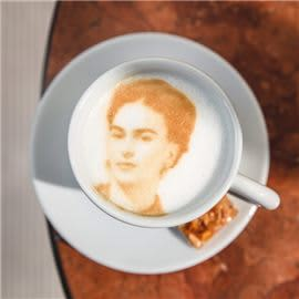 Picture of woman in coffee foam