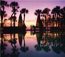 Bridal Couple at Sunset with Reflection - The Don CeSar Hotel Weddings - Bridal Couple at Sunset with Reflection