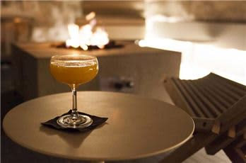 A Cocktail On A Small Round Table