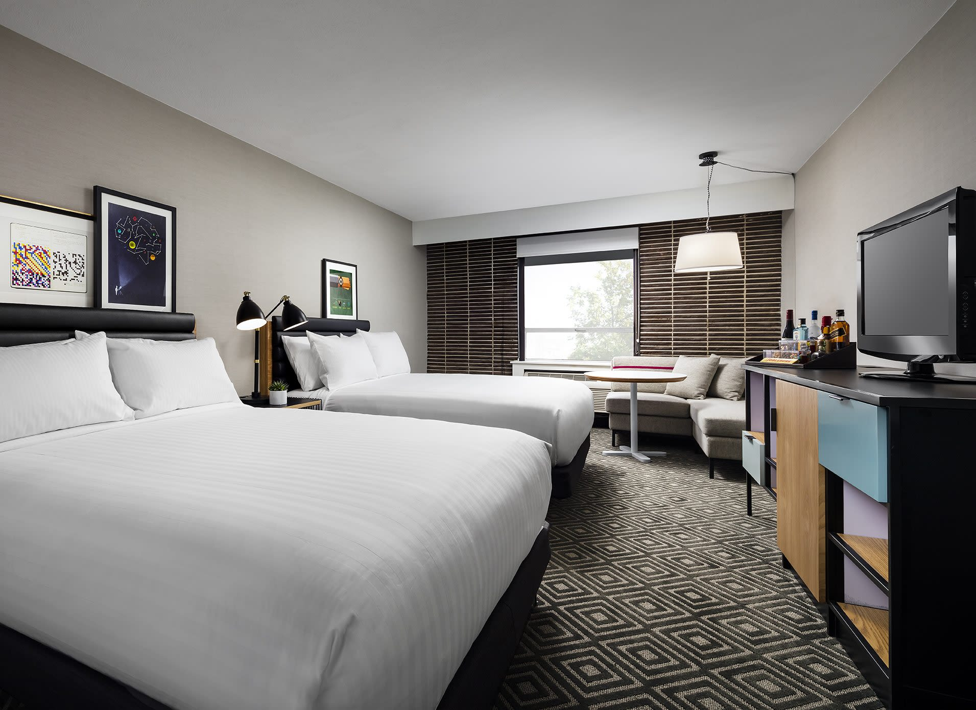 Deluxe two queen bed room at the Freepoint Hotel Cambridge, Tapestry Collection West Cambridge