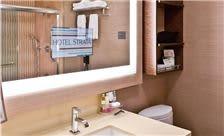 Hotel Strata Room - Bathroom TV