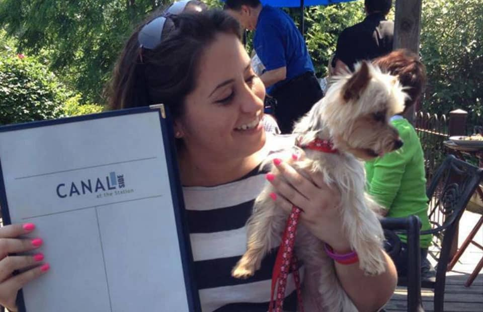 Guest and her Yorkie preparing to Order off of Lambertville's Canal Outdoor Dining Menu