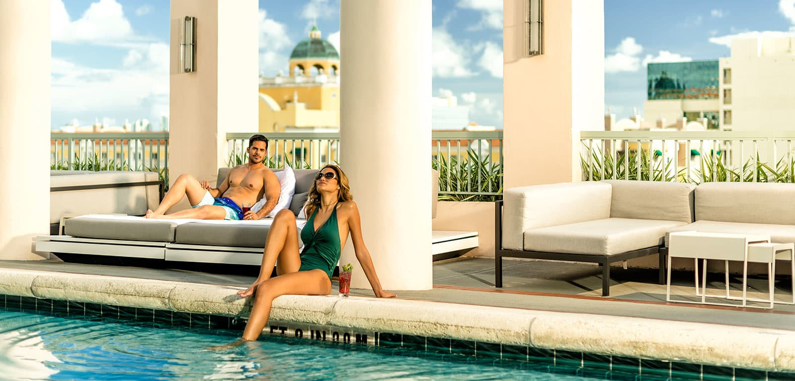 Couple Lounging Poolside at Hotel Colonnade