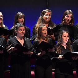 Female singers performing in a choir