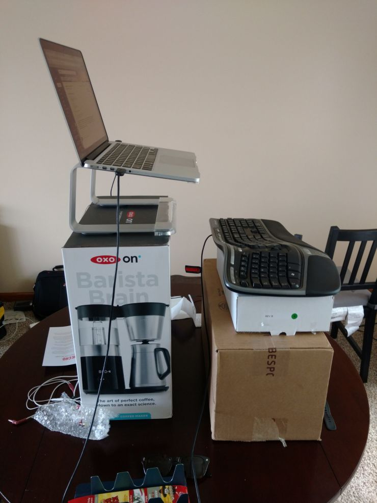 Computer equipment on boxes as a makeshift standing desk