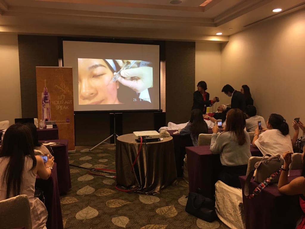 Speaking and training at a recent Seminar at the prestigious American Academy of Aesthetic Medicine b