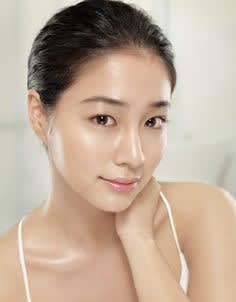 woman dewy glow face to neck