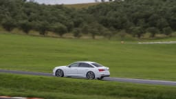 Drive Car of the Year Best Large Luxury Car 2021 finalist Audi A6 wide shot driven on road
