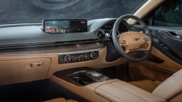 Drive Car of the Year Best Large Luxury Car 2021 finalist Genesis G80 infotainment system and steering wheel