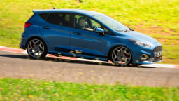 Drive Car of the Year Best Sports Car Under $100k finalist Ford Fiesta ST rear exterior driven on circuit