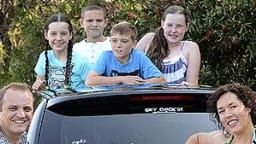 Monica Liebenow and her family with a My Family bumper sticker.