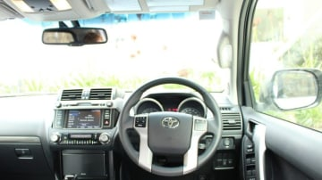 Interior: The Prado also has a very basic cabin set-up but the layout is more cohesive.