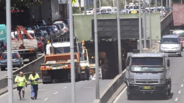 A truck has caused traffic delays after hitting sprinklers in the Eastern Distributor.