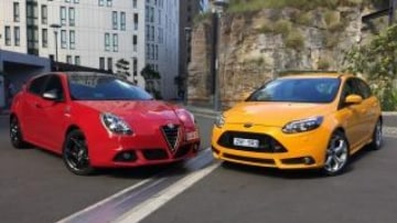 The Alfa Romeo Giulietta QV and Ford Focus ST offer different takes on he hot hatch theme.