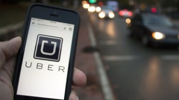 Uber invests in self-driving cars, trucks