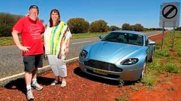 Peter and Chris Jackson with their Aston Martin V8 Vantage on the Stuart Highway.