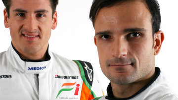 (L to R): Adrian Sutil (GER) Force India F1 with team mate Vitantonio Liuzzi (ITA) Force India F1. Force India Studio Shoot, Silverstone, England, 8 February 2010.