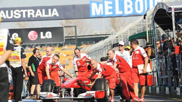 Ferrari team get ready for first practice session.