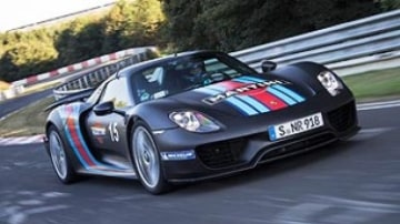The Porsche 918 Spyder tops its global debut with a Nurburgring lap record.
