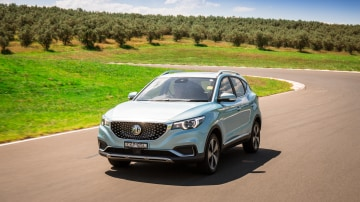Drive Car of the Year Best Electric Vehicle 2021 finalist MG ZS EV driven on winding road wide shot