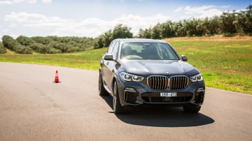Drive Car of the Year Best Large Luxury SUV 2021 finalist BMW X5 driven on road wide shot