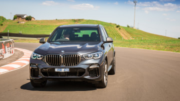 Drive Car of the Year Best Large Luxury SUV 2021 finalist BMW X5 driven around a bend