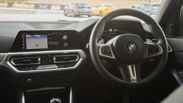Drive Car of the Year Best Medium Luxury Car 2021 finalist BMW 3 Series interior infotainment system and steering wheel