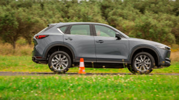 Drive Car of the Year Best Medium SUV 2021 finalist Mazda CX-5 right side view driven on road circuit