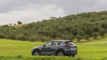 Drive Car of the Year Best Medium SUV 2021 finalist Mazda CX-5 left side view as driven on road