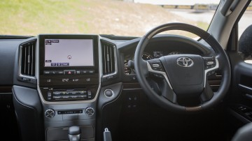 Drive Car of the Year Best Upper Large SUV 2021 finalist Toyota Landcruiser front interior infotainment system and steering wheel