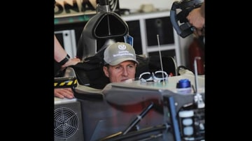 Michael Schumacher of Mercedes is fitted out in his car for first practice session.