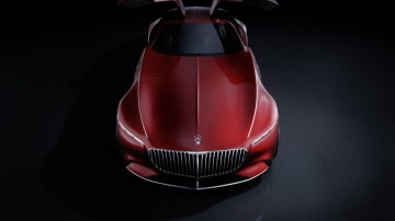 """Its distinguishing features are its extended hood, elongated """"boat tail"""" rear and gullwing, overhead-opening doors."""