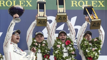 The Porsche team celebrate their victory at the Le Mans 24 Hour.