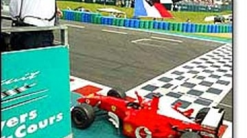 Champagne flows as humble Schumacher matches Fangio in his drive for five