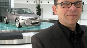 Kia chief designer Peter Schreyer with the Cee'd hatch concept car unveiled at the 2006 Geneva motor show. Many of its design cues made their way into the production version of the car. Picture: Barry Park.
